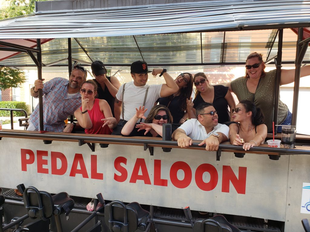 group of friends enjoying a tour with Pedal Saloon