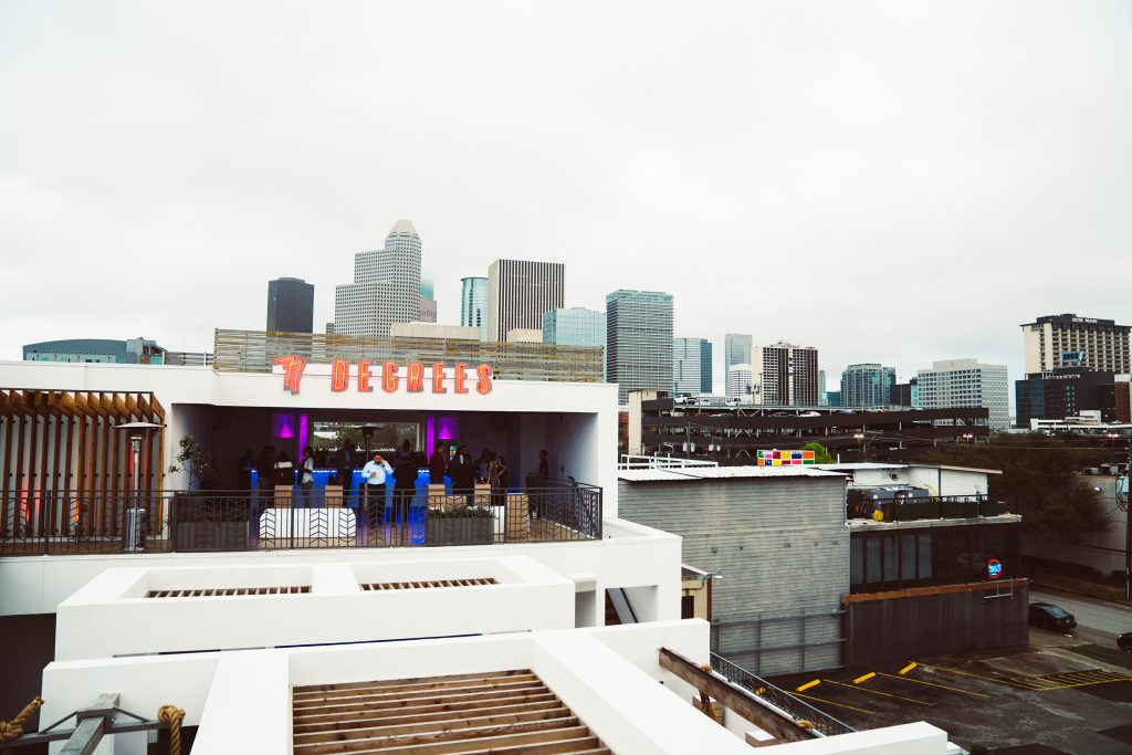 Image from the outside of the bar 77 degrees in Houston