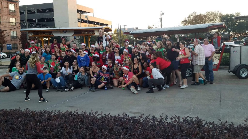Group of people joining a Pedal Saloon tour in Houston for Christmas