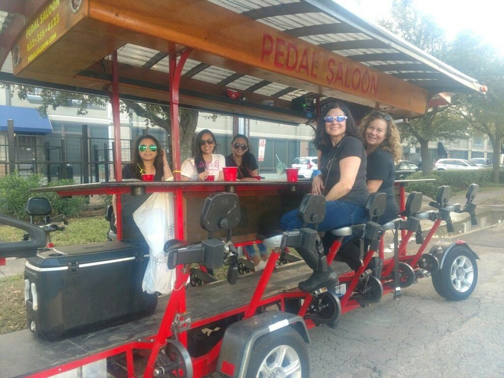 Clients enjoying a Pedal Saloon tour in Houston