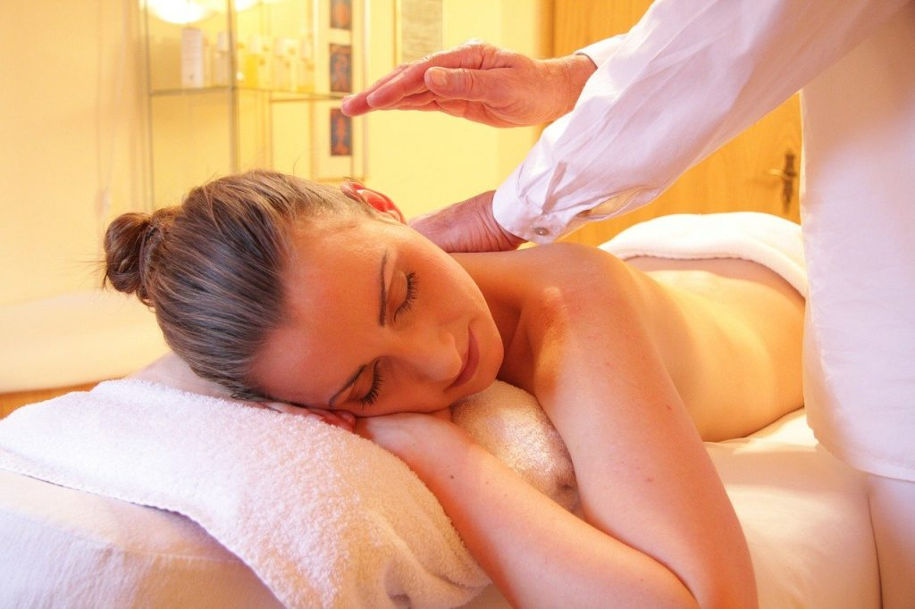 Image of a woman in a Spa during a back and shoulder massge
